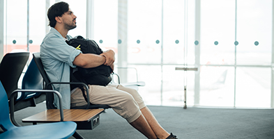 Man waiting at airport gate