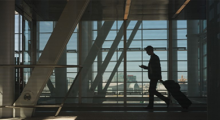 Man walking through interior of Union Pearson Express station at airport